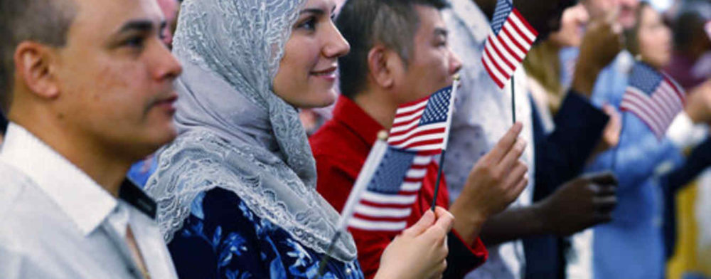 New citizens celebrate after taking the Oath of Allegiance during a naturalization ceremony, Friday, Jan. 18, 2019, at the U.S. Citizenship and Immigration Services field office in Oakland Park, Fla. One hundred fifty-four people from 42 countries took the oath during the ceremony. (AP Photo/Wilfredo Lee)